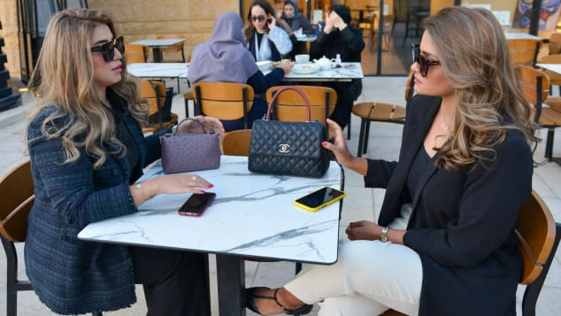 Saudi women chat in a coffee shop -- until recently they would've needed to cover their heads and be accompanied by a man. FAYEZ NURELDINE/AFP via Getty Images