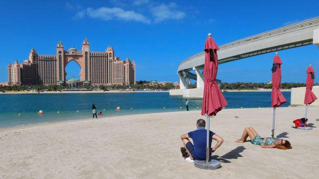Dubai is facing tighter restrictions after a spike in Covid-19 cases. That's Atlantis the Palm in the background.