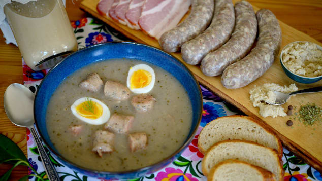 The savory Polish dish żurek, or sour rye soup, often is served with sausage and a boiled egg, along with horseradish for a spicy kick.