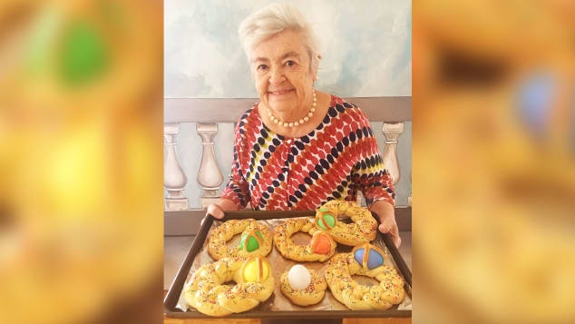 Nonna Romana holds scarcella, a braided Easter bread decorated with colorful hard-boiled eggs. Her granddaughter, RossellaRago, said Romana made them every Easter for all the kids.