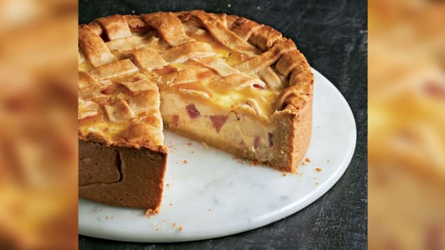 Stuffed with meat and cheese, Italian pizza rustica is served at room temperature on Easter Sunday.