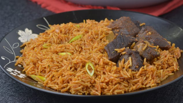 Jollof rice is a classic Nigerian dish. Lola Osinkolu's recipe uses roasted bell peppers, tomatoes, onions and garlic. She also includes beef stock to give it a rich beefy taste.