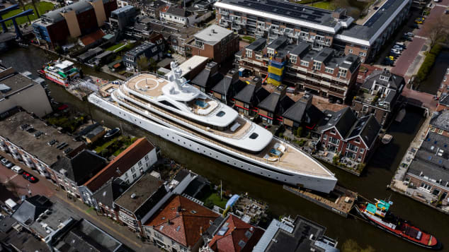 Feadship's new superyacht Project 817 is guilded through the canals of Holland while en route to the North Sea.