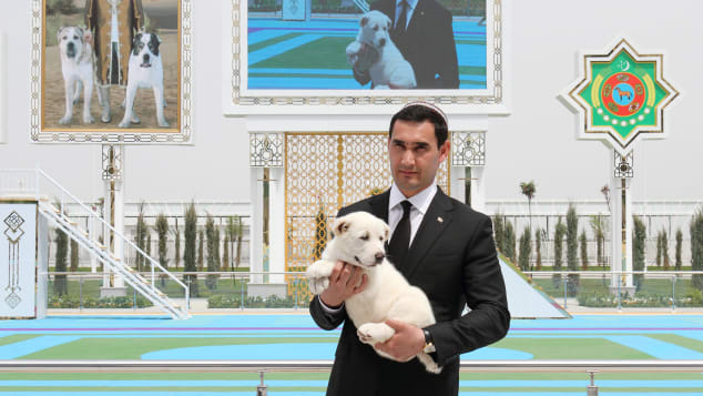 Serdar Berdymukhamedov, the President's son and deputy, holds a puppy during the event.