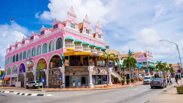 Aruba is known for its white beaches and colorful buildings in the capital city of Oranjestad.