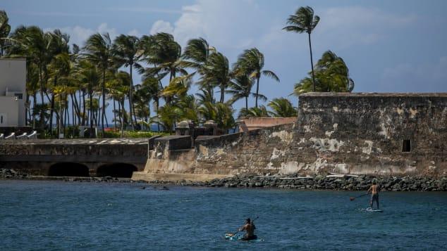 Paddleboarders enjoy themselves near a beach in the Condado neighborhood of San Juan.