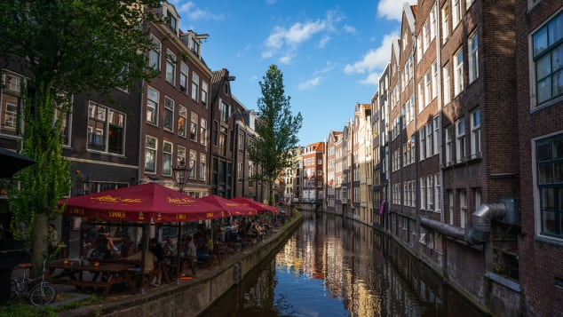 A view of an Amsterdam canal on August 19. The Netherlands got moved on Tuesday to the CDC's Level 3, an improvement over its previous Level 4 placement.