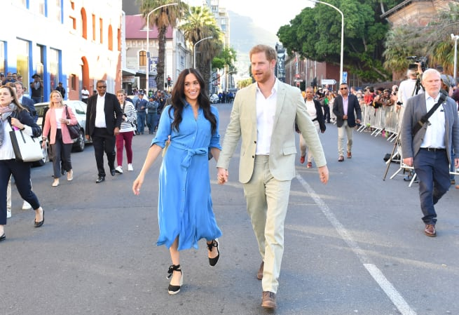 Meghan and Harry visit District 6 Museum in Cape Town, South Africa. Meghan wears a Veronica Beard dress previously seen on the couple's 2018 royal tour of Australia, the Kingdom of Tonga, Fiji and New Zealand.