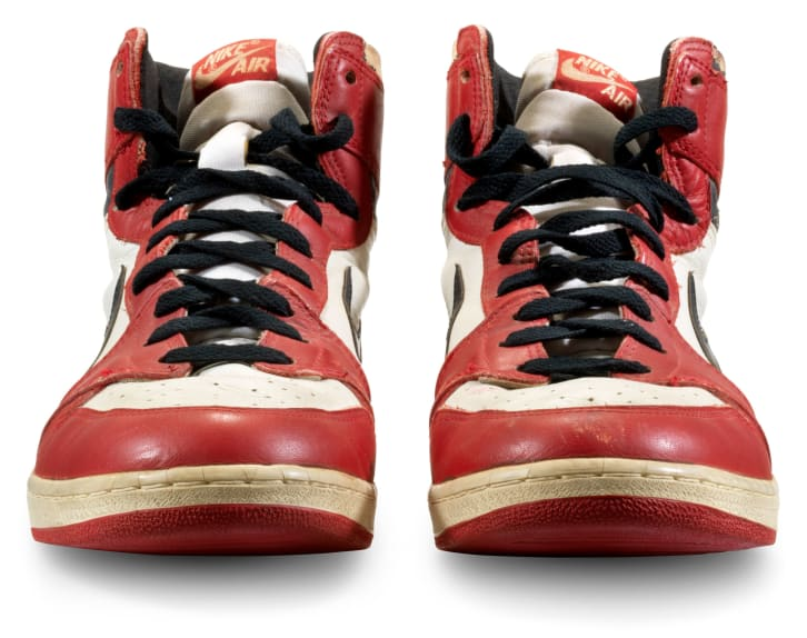 A pair of Michael Jordan's sneakers from 1985 have sold at auction for $615,000.