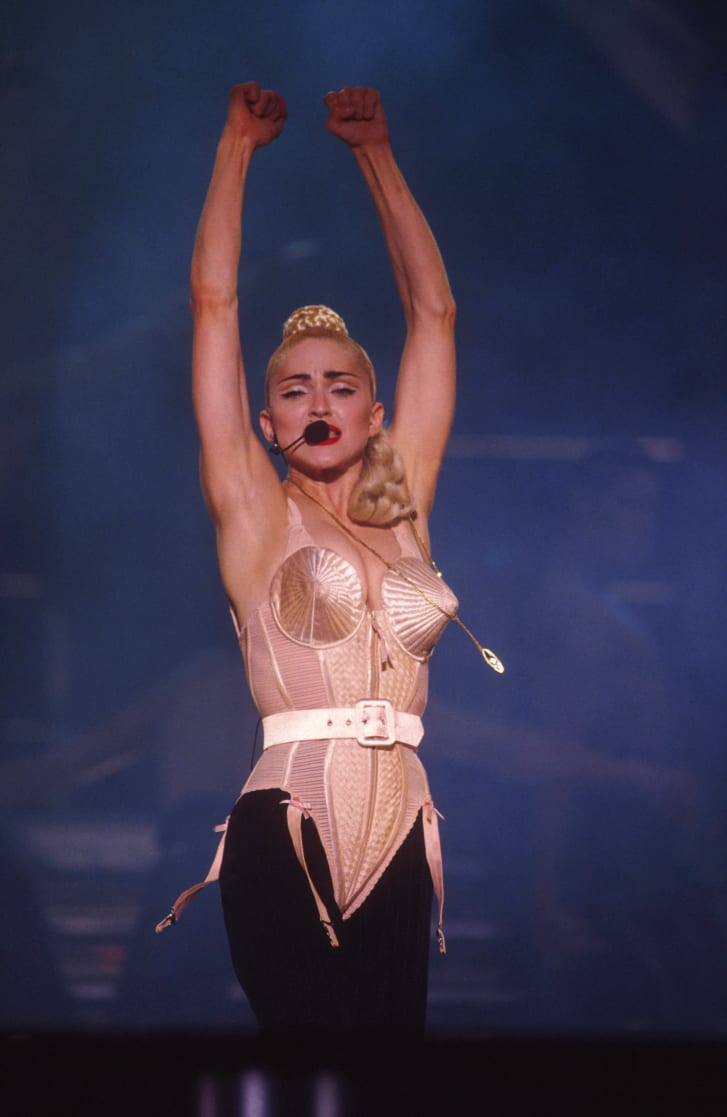 Madonna performing in her cone shaped bra from the Blond Ambition tour.