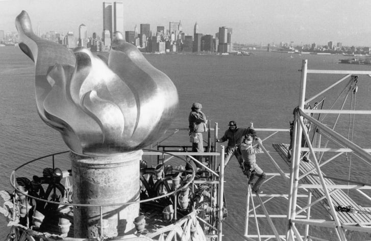 The original torch being replaced in 1985.