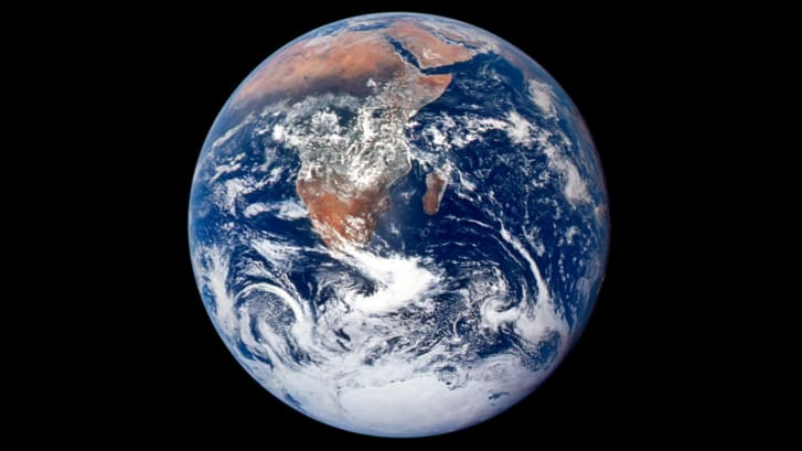 View of the Earth as seen by the Apollo 17 crew traveling toward the moon, known as 'Blue Marble.'