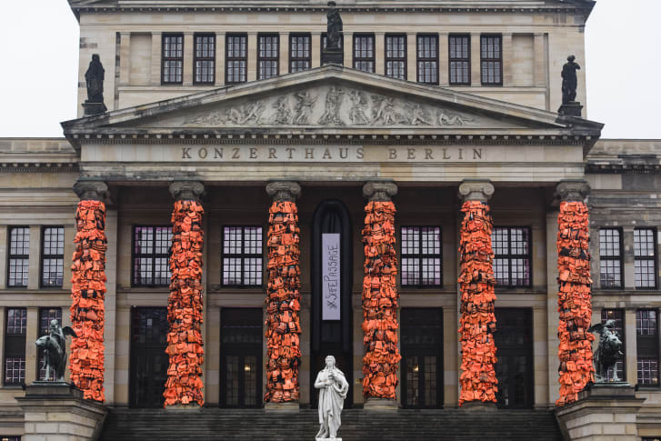 An art installation by Chinese artist Ai Weiwei that consists of life vests worn by refugees bound to the columns of the concert house at Gendarmenmarkt on February 14, 2016 in Berlin, Germany.
