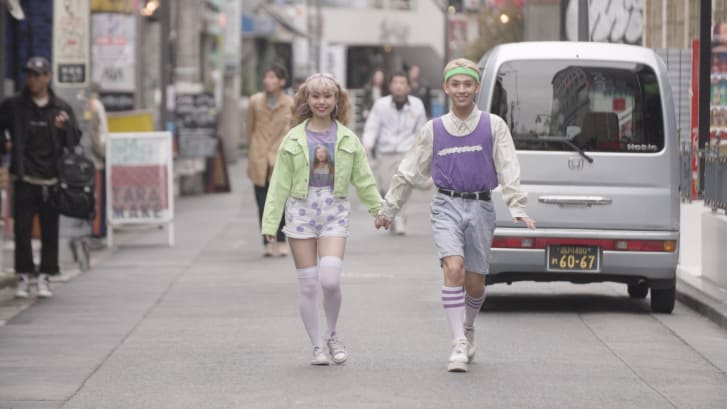 Ryuchell (right) walking through the streets of Tokyo with his wife Peco.