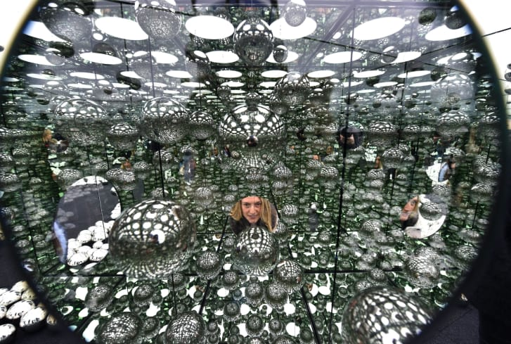 """""""INFINITY MIRRORED ROOM: LET'S SURVIVE TOGETHER"""" (2017) by Yayoi Kusama."""