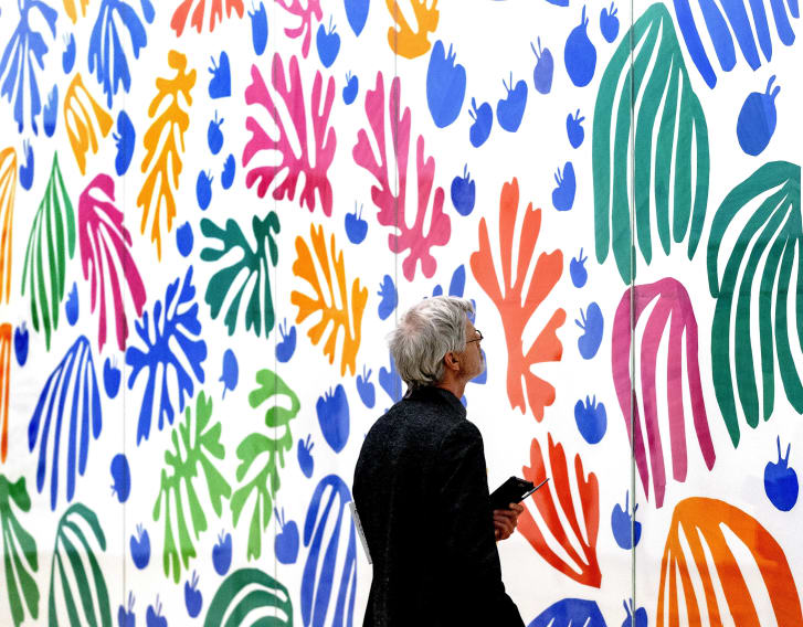 """A visitor examines """"La Perruche et la Sirene"""" by French artist Henri Matisse at the exhibition """"De Oase van Matisse"""" at the Stedelijk Museum Amsterdam in 2015."""