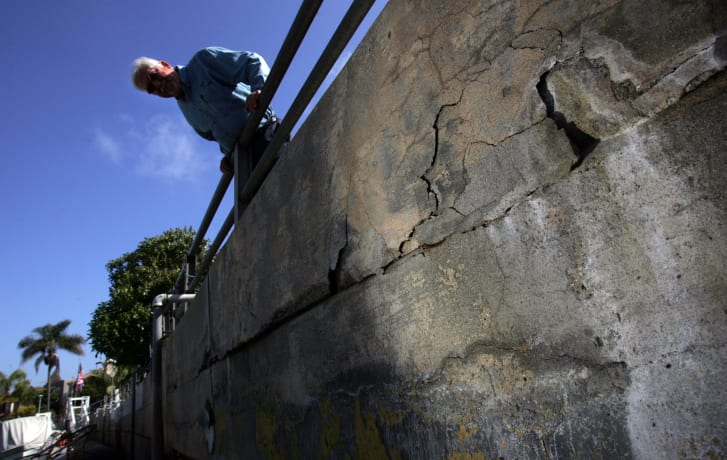 A sea wall in Naples Island, California shows signs of degradation. Salt air is one of a number of factors that can shorten the lifespan of concrete.