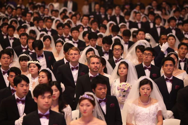 Some 4,000 'Moonies,' believers of Unification Church which was named after the founder Moon Sun Myung, attend the mass wedding which began in the early 1960s.