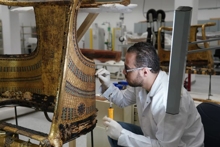 Rami Magdy works on the restoration of a chariot from Tutankhamun's tomb at the Wood Laboratory in the Grand Egyptian Museum's conservation center. The first phase of the GEM will open the end of this year and will feature a special display of thousands of treasures from Tutankhamun's tomb, many never before on dislplay.