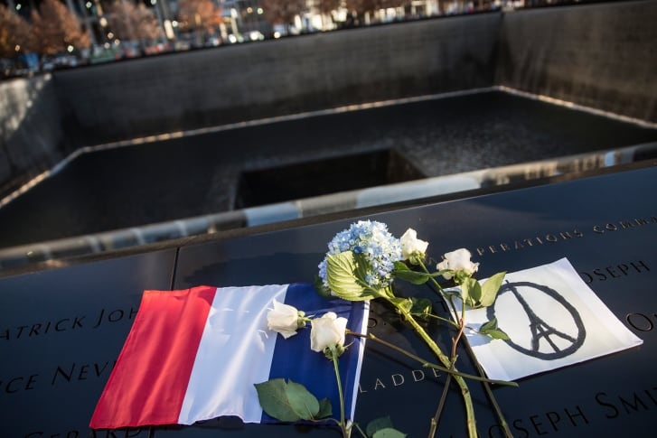 A modified version of the peace symbol showing the Eiffel tower at the September 11 Memorial in New York City honors the lives lost in the Paris attacks of Nov. 13, 2015.