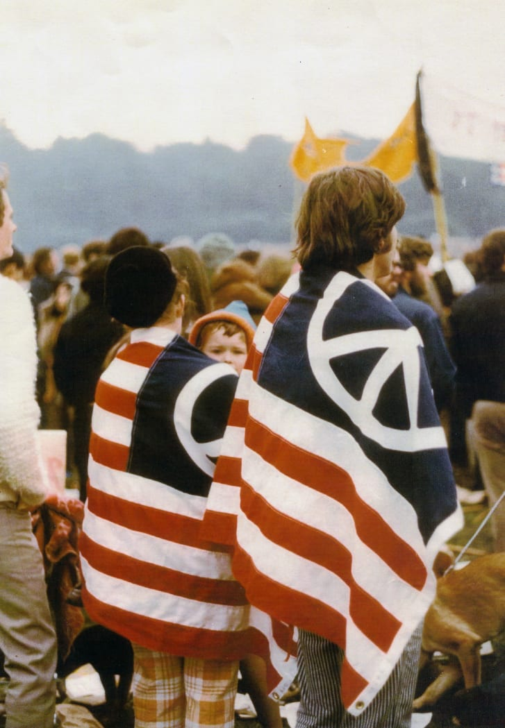 A couple wears an American flag modified with the peace symbol in an anti-Vietnam war protest in San Fracisco on Nov. 15, 1969.