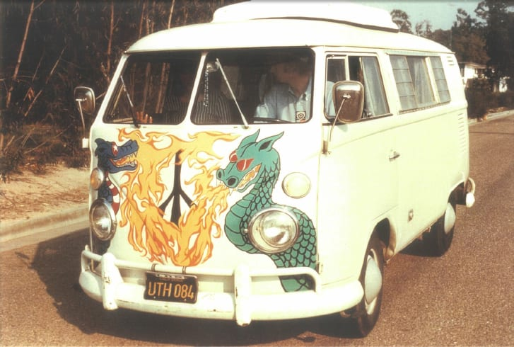 A VW bus with an elaborately painted peace symbol replacing the VW bug.