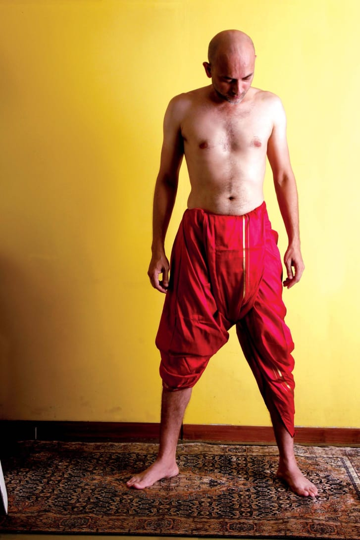 "The dhoti can be wrapped around the body, creating pleats in the front to give it style. It was the most common lower garment worn by men in India, before the 19th century demanded more ""cosmopolitan clothing."""