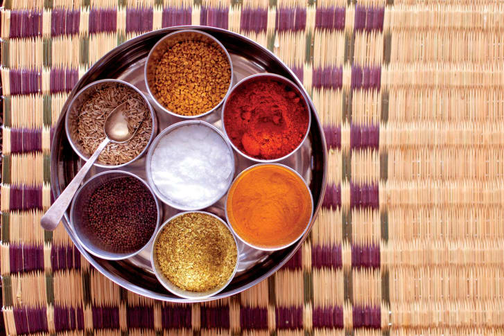 The masala dani holds all spices commonly used in Indian cooking. Though traditionally made of wood to let spices breathe, stainless steel is now the modern alternative because it does not rust.