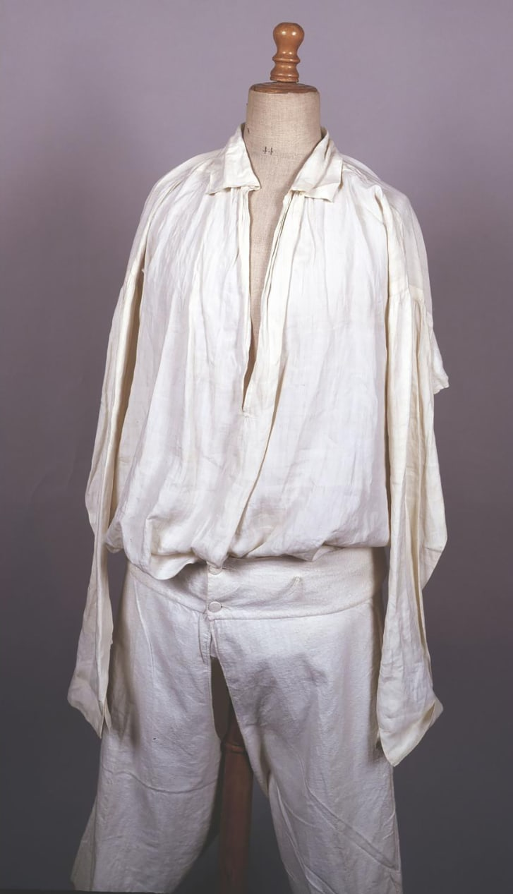 Shirt and long johns worn by Emperor Napoleon I on St. Helena island. The shirt is stained with blood. Napoleon wore it at the very end of his life. Both pieces are embroidered with the imperial initials.