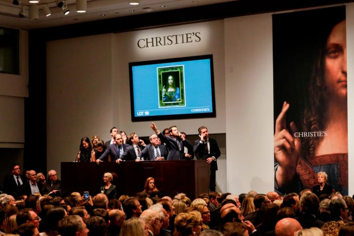 "Agents speak on their phones with their clients while bidding on at the auction of Leonardo da Vinci's ""Salvator Mundi"" during the sale at Christie's on Nov. 15, 2017 in New York. The rediscovered masterpiece  sold for an historic $450M, obliterating the previous world record for the most expensive work of art at auction."