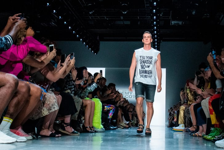 """Jeremy Scott walks his own runway in a shirt that says """"Tell Your Senator No on Kavanaugh."""""""