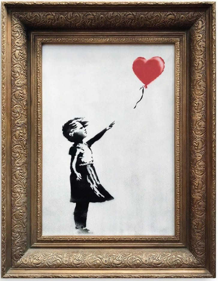 An image of Banksy's Girl with Red Balloon painting that self-destructed just moments after being sold in London.