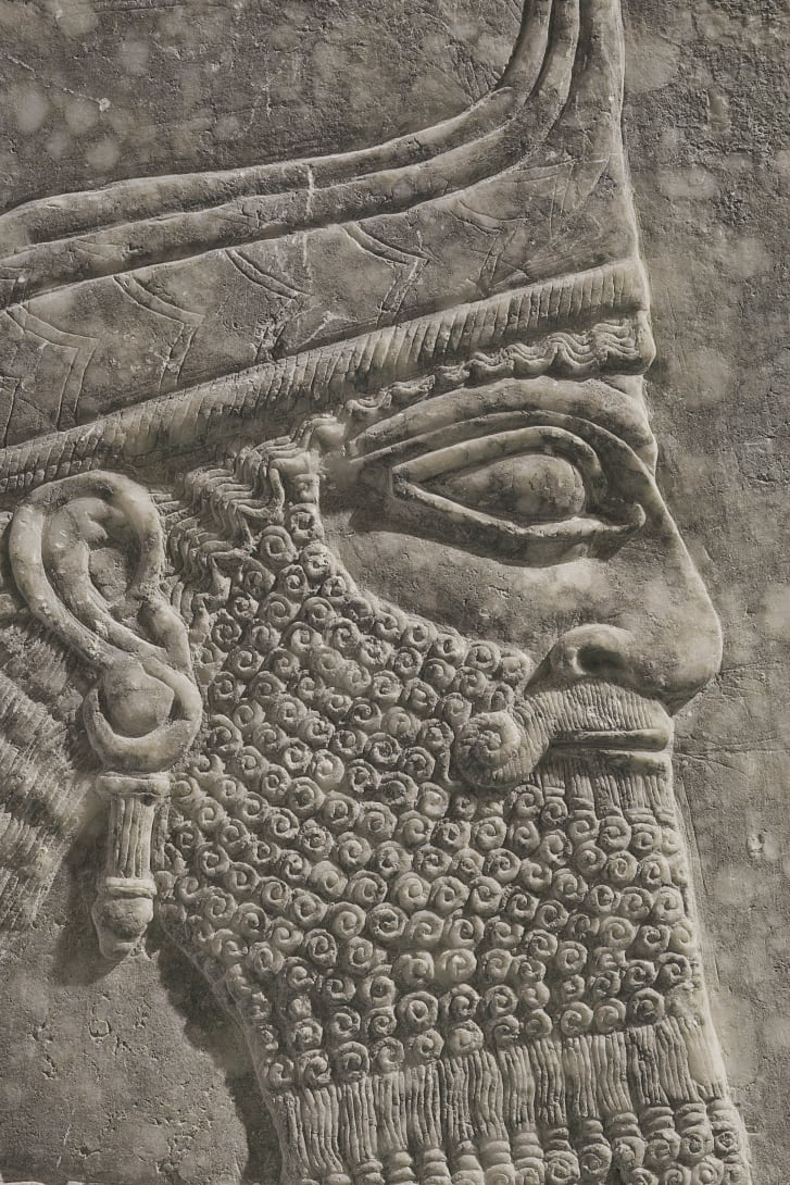 The bearded winged genius bears a striking resemblance to King Ashurnasirpal II.