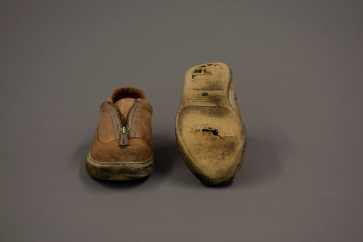 """Alexandria Ocasio-Cortez's campaign shoes is on loan to the Cornell Costume & Textile Collection for the exhibition """"Women Empowered: Fashions from the Frontline."""""""