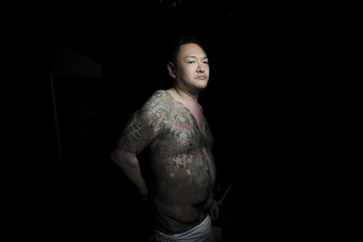 A man shows his traditional-style Japanese tattoos during the Sanja Matsuri festival in Tokyo. Over 1.5 million people flocked to Tokyo's Asakusa district during the three-day annual festival, which heralds the coming of summer in the Japanese capital.