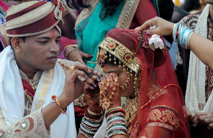A Hindu Jain groom assists his bride as the 'Mangal Sutra' -- 'Holy Auspicious Thread.'