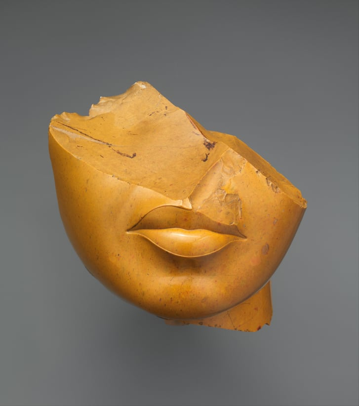 A statue from around 1353-1336 BC, showing part of a Queen's face.