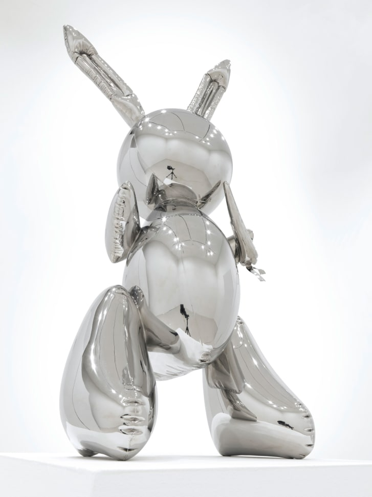 3 foot tall shiny stainless steel Rabbit at the auction