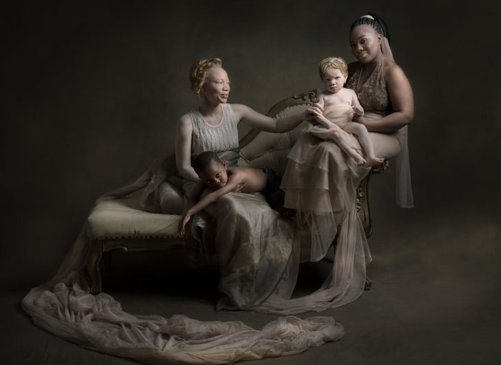 Grace Adeoshun (L) works with the Albino foundation in Lagos and has shown a lot of support for people with albinism. Here she is pictured with a dark-skinned mother, and her beautiful children in a show of support and bonding.