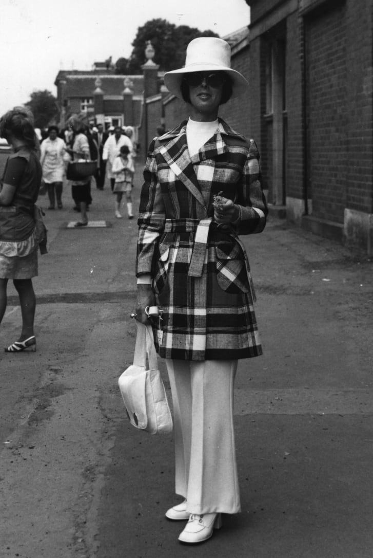 A woman wears a trouser suit and jacket at Royal Ascot in 1970.
