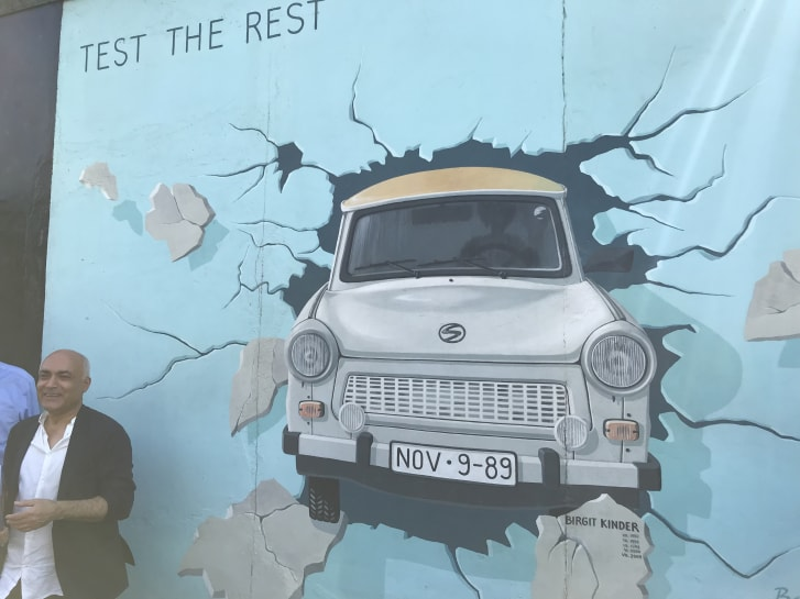 Alavi helped convince an East German artist to paint a now-famous image of her car driving through oppression.