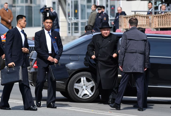North Korean leader Kim Jong Un steps out of a vehicle for a ceremony upon his departure from Russia, outside the railway station in the far-eastern Russian port city of Vladivostok on April 26. This does not appear to be one of the two vehicles discussed in the C4ADS report.