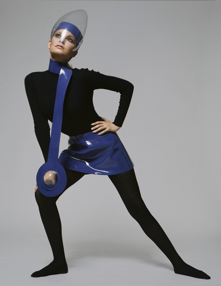 American actress Raquel Welch in a futuristic outfit featuring a mini skirt and scarf in blue plastic, worn with a perspex visor, circa 1967.