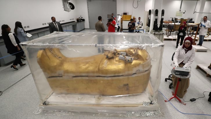 Tutankhamun's gilded coffin undergoes restoration                  at the conservation center in the Grand Egyptian Museum.