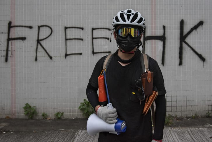 A protester wearing a mask during anti-government protests, which began in response to a proposed extradition law, in Tai Po, Hong Kong, on August 10, 2019.