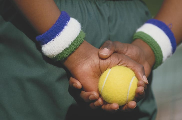 A ballboy holds a tennis ball in preparation during the Wimbledon Lawn Tennis Championships in London, England in 1987.