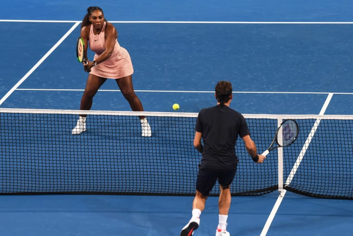 Serena Williams and Roger Federer during their mixed doubles match on day four of the Hopman Cup tennis tournament in Perth on January 1, 2019.