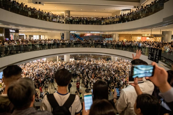 Protesters sing songs and shout slogans after gathering at the IFC Mall on September 12, 2019 in Hong Kong.