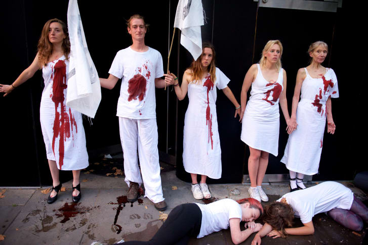 Extinction Rebellion called for the cancellation of London Fashion Week, with activists gluing themselves to the entrance of the event's central venue.
