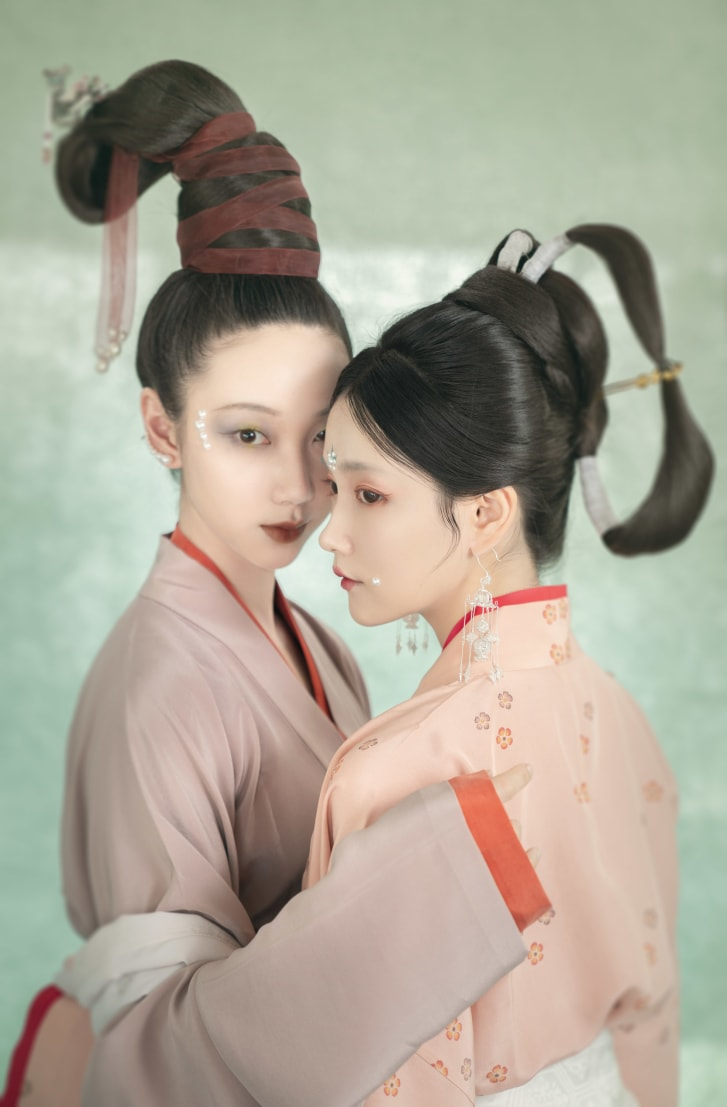"""""""Hanfu"""" refers to ancient clothing worn before the Qing dynasty. Young Hanfu fans model the fashion's characteristic wide sleeves and sweeping robes in highly stylized photo shoots."""